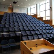 Picture of Forum Hall with podium and theater style seating