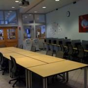 Plaza room in palmer commons with a large conference table in the center with chairs around
