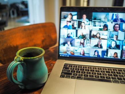 Video Conferencing on a laptop with coffee